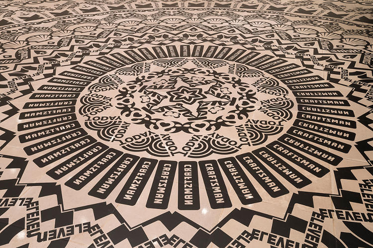 "<p>She describes the installation as ""viral,"" saying, ""the symbols and patterns in this mandala transform into an image of how our daily rhythm of commonplace doings blends with advertising and enters deep into our lives, homes, and minds.""</p>"
