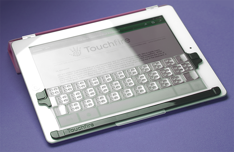 <p>The original Touchfire keyboard was big enough to simply sit over the iPad's virtual keyboard and map to its keys exactly.</p>
