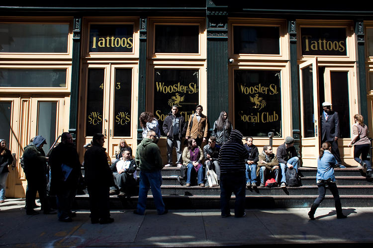 <p>Fans wait outside Wooster Street Social Club in New York City to receive free Game of Thrones tattoos Friday March 30, 2012.</p>