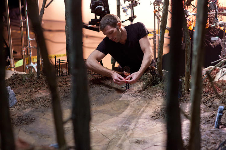 <p>Producer and Head Animator Travis Knight at work with Norman on the graveyard set.</p>