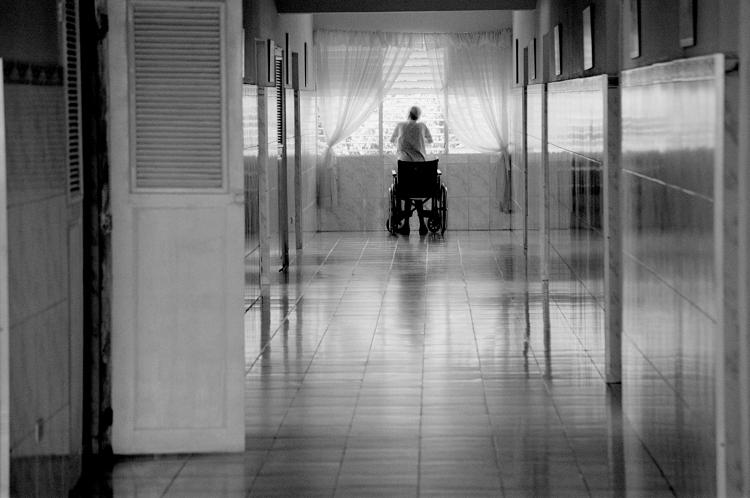 <p>&quot;This was a crazy thing. We went to an old folks home run by nuns, a fairly large facility. We were touring through and as everyone walked ahead, I saw this woman in a wheelchair at the end of the hall, looking out the window. The image was so intense for me as the photographer, I almost felt like I had to get out of there.&quot;</p>