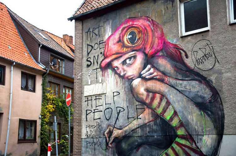 <p>German artists <strong>Hera</strong> and <strong>Akut</strong> painted this mural,<em>Art Doesn't Help People, People Help People</em>, during the Arotale Festival in Lueneberg, Germany.</p>