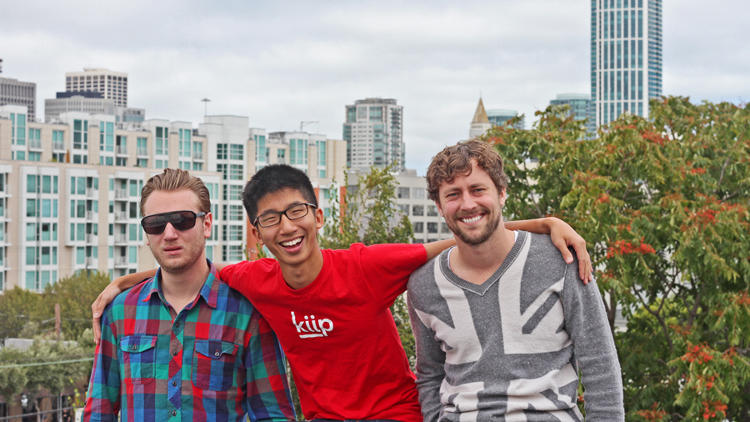 <p>Brian Wong (center), founder of Kiip.</p>
