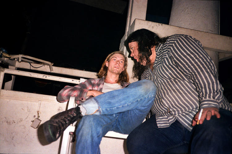 <p>Pumped up after threatening to jump from a 15-foot-high PA stack at the Piper Club in Rome, Kurt Cobain winds down with Sub Pop label-mate Tad Doyle of the band Tad. Source: <a href=&quot;https://itunes.apple.com/us/book/experiencing-nirvana-grunge/id575827071?mt=11&quot; target=&quot;_blank&quot;><em>Experiencing Nirvana: Grunge In Europe, 1989</em></a></p>