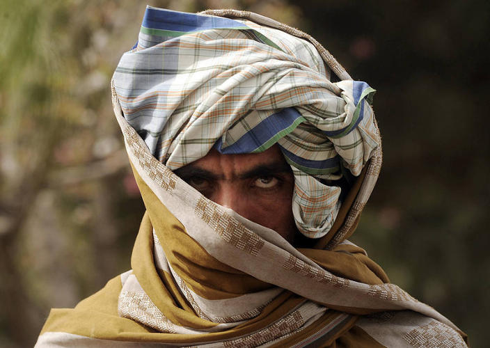 <p>Don't get on this dude's bad side. A former Taliban fighter glares, meanly, after joining Afghan government forces on March 26, 2012.</p>