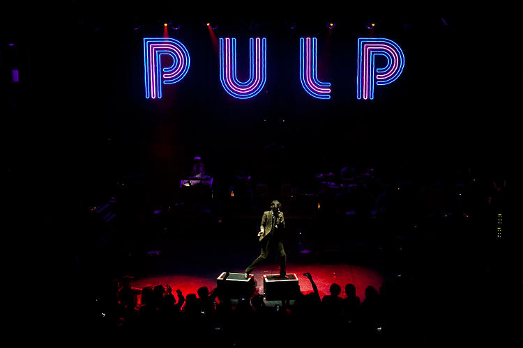 <p>Pulp's giant hanging letters, which vigorously swayed during the band's set, were a visual indicator that we were nowhere near a desert.</p>