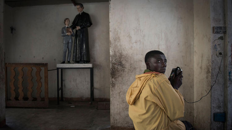 <p>Kamara Serbungo fled his home and a refugee camp in Democratic Republic of the Congo when rebel soldiers tried to enlist him. He's now taking shelter at the Don Bosco parish.</p>