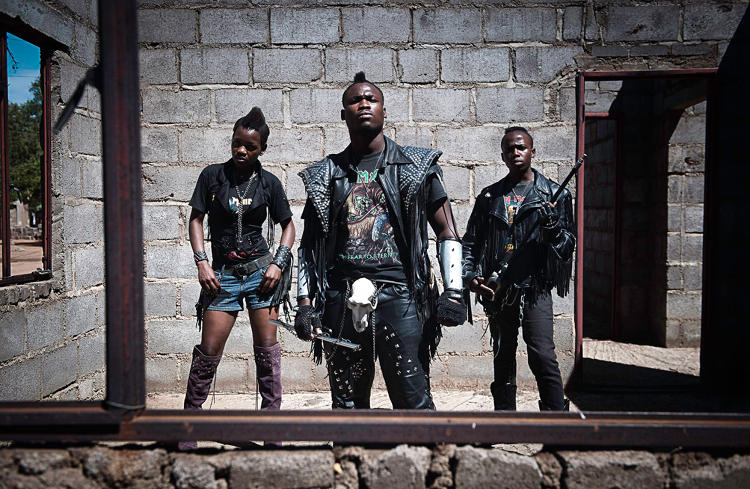 <p>Metal rockers Edith, Hellrider, and Dadmonster pose in Botswana, where groups who shred are now performing in nightclubs, concerts, and festivals.</p>