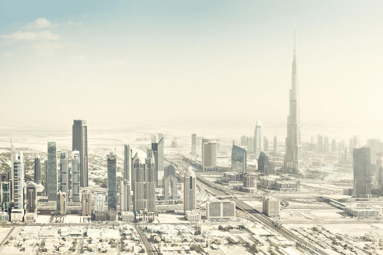 <p>An aerial view of the desert city of Dubai hints at the frequent sandstorms involved in living there.</p>