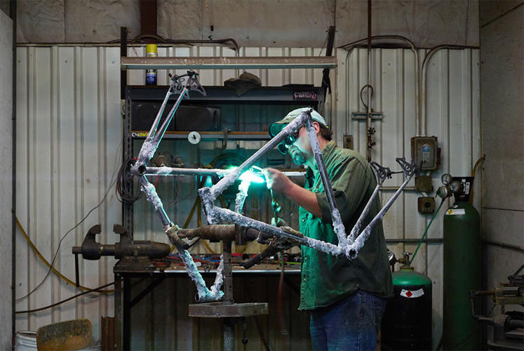 <p>Welding a bike frame at Waterford</p>