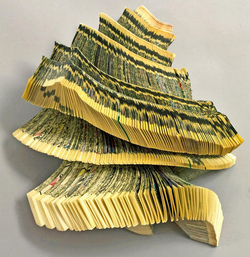 <p>Brooklyn book sculptor Doug Beube began altering books in 1979 by cutting, folding, gouging, piercing, and slashing. He excavates found books as if they were undiscovered archeological sites,&quot; reports <em>Art Made From Books.</em></p>