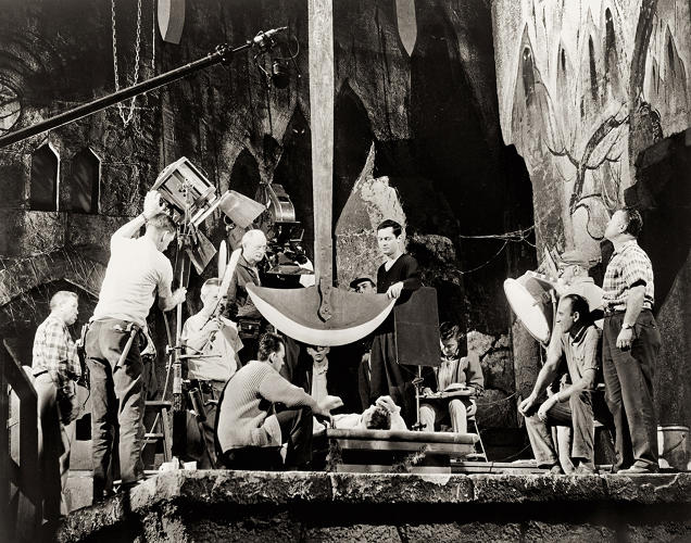 <p>Photo from the set of <em>The Pit and the Pendulum</em> (1961), directed by Roger Corman. Corman and his crew set up the climactic shot of his second installment in the Poe saga. Thanks to his trusted cinematographer Floyd Crosby and his ace production designer Daniel Haller, Corman managed to make the Poe films look every bit as rich and sumptuous as the movies coming out of the big studios. Eye candy on a budget.</p>