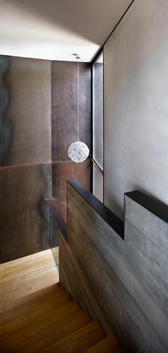 <p>Noguera's architectural fingerprint is detailed in sleek cor-ten fireplaces, brushed aluminum pendant lights, and a shadowy, elegant pool.</p>