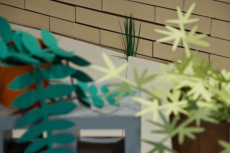 <p>Houseplants like ferns are rendered leaf by leaf in paper.</p>