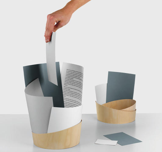 <p>Marie Douel's A4 concept lets you build your own waste paper basket out of the waste paper itself, with just a curl of wood to get you started.</p>