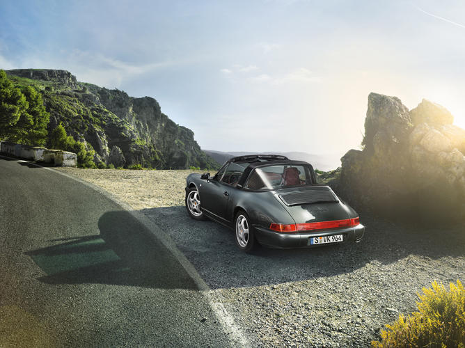 <p>The first Porsche 911 Targa, with its removable glass top, was invented in 1966, to comply with a potential ban in the U.S. on soft-top convertibles. But since then, that design detail has been carried forward in several generations of 911.</p>