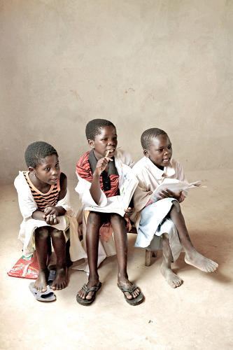 <p>English photographer Giles Duley snaps three Angolan children on their first day of school (2008).</p>