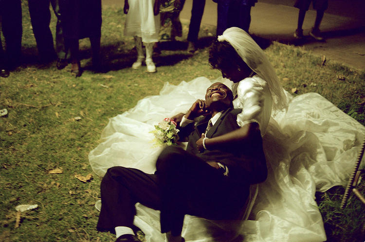 <p>Newlyweds at a park in Uganda weeks after the country's civil war ended in 2002. By Lori Waselchuk.</p>