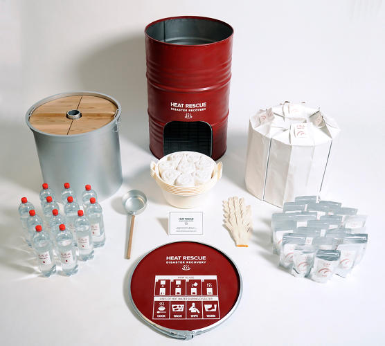 <p>The Heat Rescue Disaster Recovery set contains a pot, a manual for turning the drum into a wood-burning stove, packages of freeze-dried rice, bottled water, utensils, towels, work gloves, and 200 portions of pre-cooked food.</p>