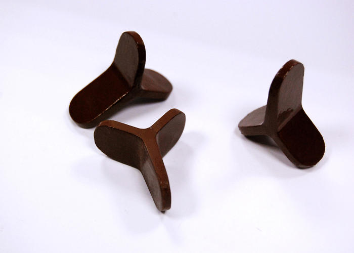 <p>A three-tined chocolate piece for dessert.</p>