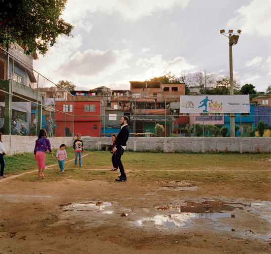 <p>Rosenbaum with young residents on one of the new playing fields.</p>