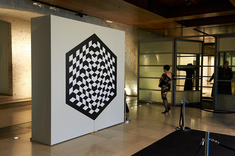 <p>Their strategy started with this logo, a mind-bending, trompe-l'oeil take on a chessboard. Its enigmatic presence reminds me of a secret society--like we're crashing a crafty villain's party in a James Bond film.</p>