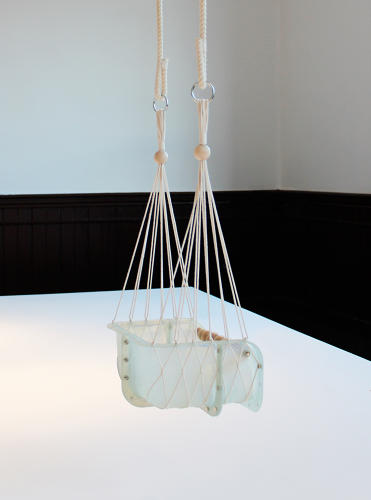 <p>Christiane Hoegner hung part of an OS standard component, called a BlocBox, from a woven string net to create a kids' swing.</p>