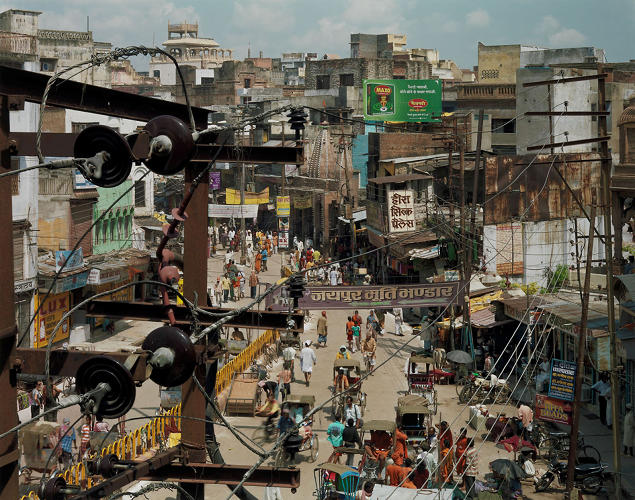 <p>Robert Polidori, <em>Dashashwemedh Road</em>, Varanasi, India, 2007. The image is &quot;a digital composite of two large-format negatives, each precisely focused on a different segment of the scene--an assemblage of 'decisive moments' combined into a single dynamic image.&quot;</p>