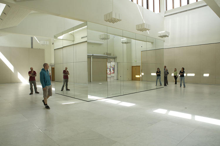 <p>Outside, the mirrors serve to camouflage the structure.</p>