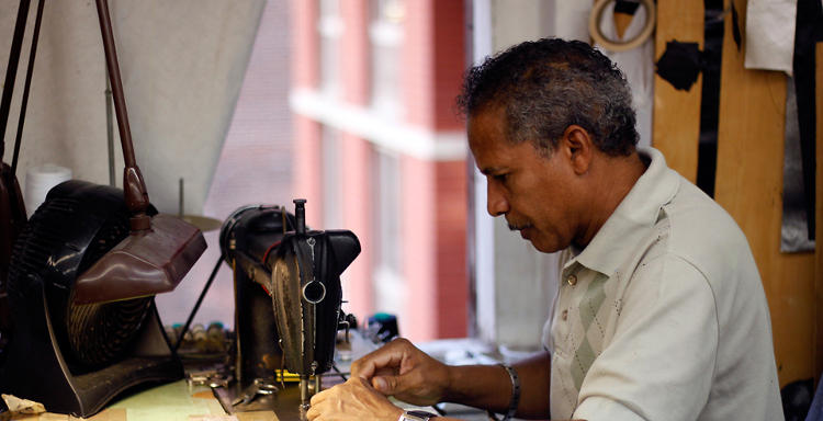 <p>Leather straps being sewn for belt production at Universal Elliot Corp., a father-son leather goods manufacturer.</p>