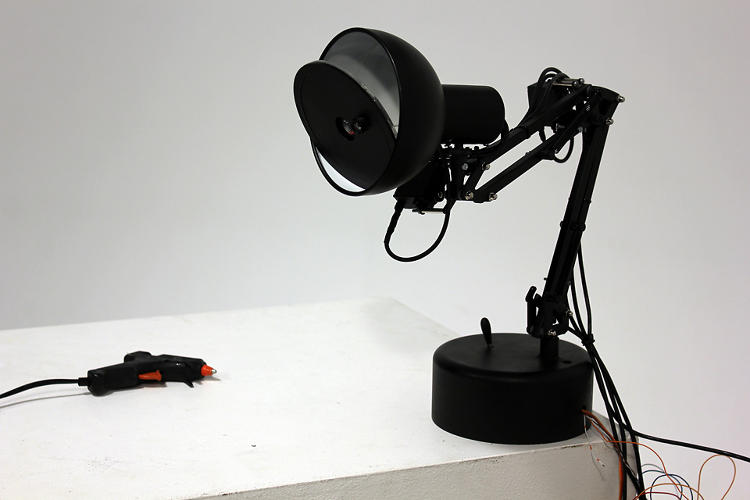 <p>It was built by three students at Victoria University of Wellington, who combined a desk lamp with six servo motors, a webcam, some Arduino, and a bit of Processing magic.</p>