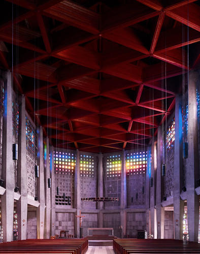 <p>The rainbow-colored windows and red diamond ceiling of Nicholas Kasiz' St.Remy, which opened in 1957.</p>