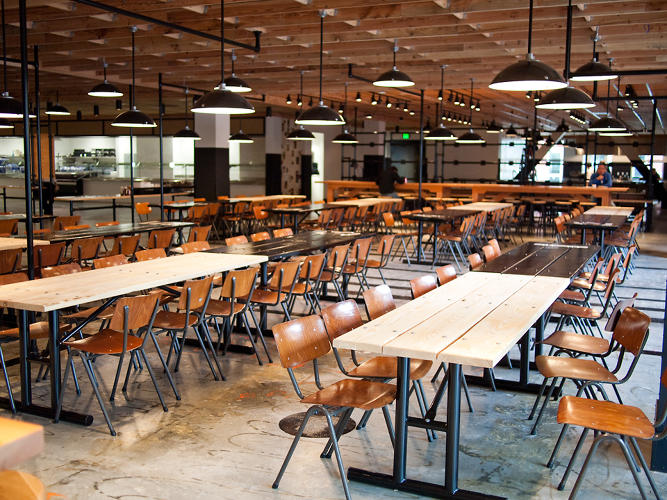 <p>It's full of reclaimed furniture and custom pieces, all which create a post-industrial space that's reminiscent of a schoolhouse or factory.</p>