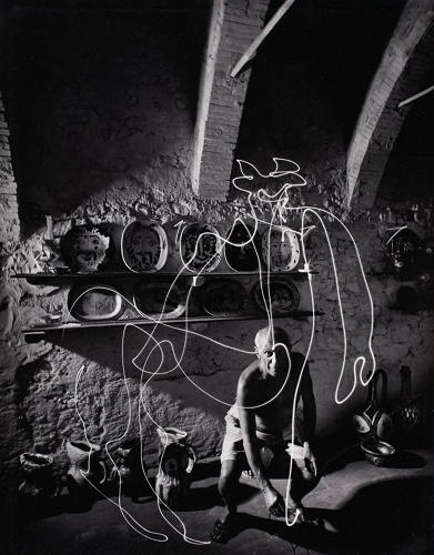 <p>Gjon Mili's 1949 photograph of Picasso, in which the artist draws a centaur.</p>