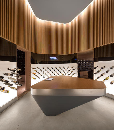 <p>Wine bottles seem to levitate from the illuminated walls.</p>