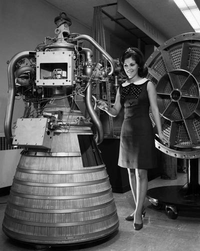 <p><strong>Miss NASA 1968</strong><br /> In the late 1960s/early '70s, NASA held a beauty pageant. This is Miss NASA 1968-69, standing by a RL-10 engine display in the Rocket Operations Building.</p>