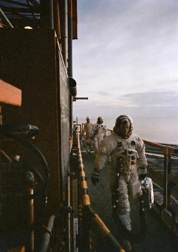 <p><strong>Apollo 11 Strut</strong><br /> The crew of the Apollo 11 lunar landing mission (the mission that walks on the Moon) arrives atop Pad A, Launch Complex 39, Kennedy Space Center, during the Apollo 11 prelaunch countdown. Leading is Astronaut Neil A. Armstrong, commander, He was followed by Astronauts Michael Collins, command module pilot. Technician follows directly behind Armstrong and Collins.</p>