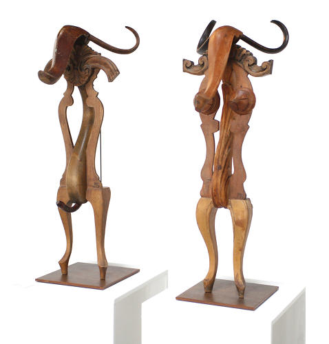 <p>The heavy oak legs of an armoire became these bullish figures.</p>