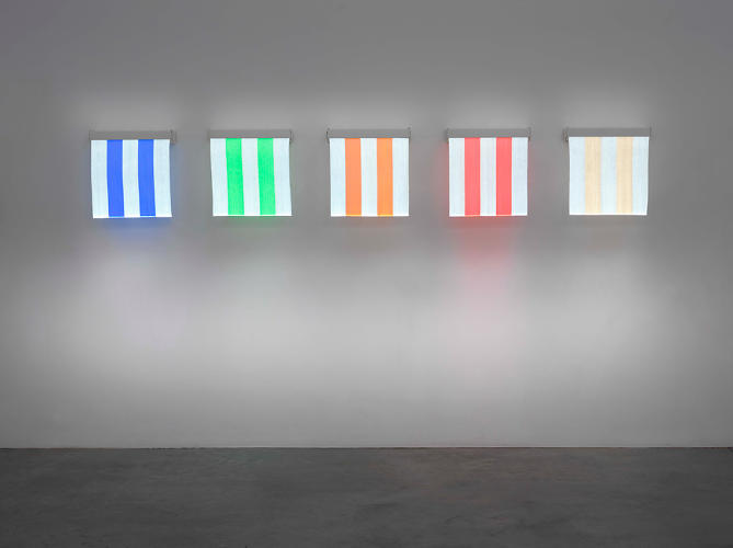 <p>The stripe colors change, but white is always the alternate shade. Here, five portrait-sized pieces in <em>One Thing to Another, Situated Works</em> at Lisson.</p>