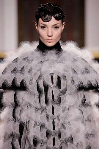 <p>Another dress exploited the movement of thousands of tiny hairs of flexible plastic.</p>