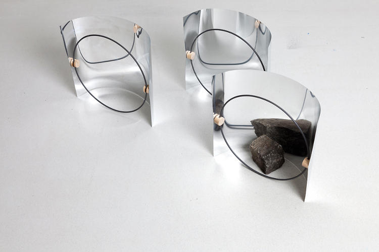 <p>PI, by Annika Frye, is an object and candle holder.</p>