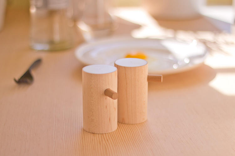 <p>The salt-and-pepper shakers are offered in American Walnut and hard white Maple, both with a Corian top.</p>