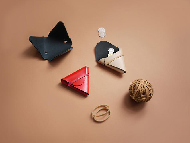 <p>Each of the items in Chieh Ting Huang's Nothing Fancy series of wallets is composed of a strategically folded, single piece of leather with a custom rubber band to hold it all together.</p>