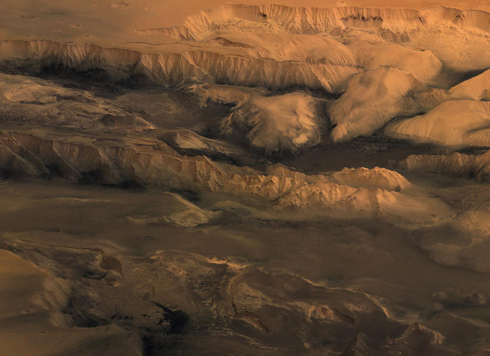 <p>The ESA calls the system &quot;unparalleled in the solar system.&quot; Here, we see the middle of the canyon.</p>