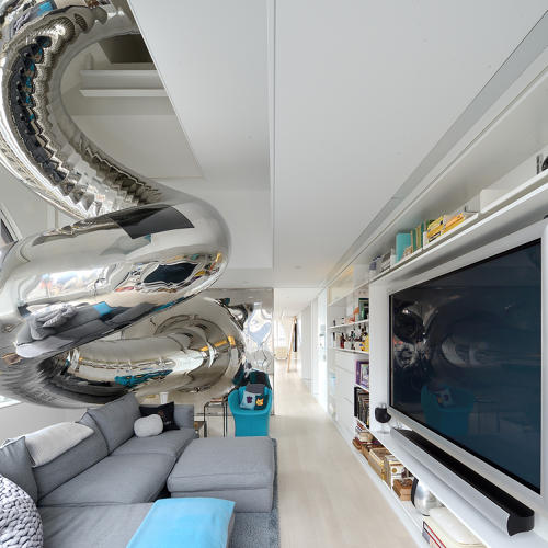 <p>The slide brings you right into the living room.</p>
