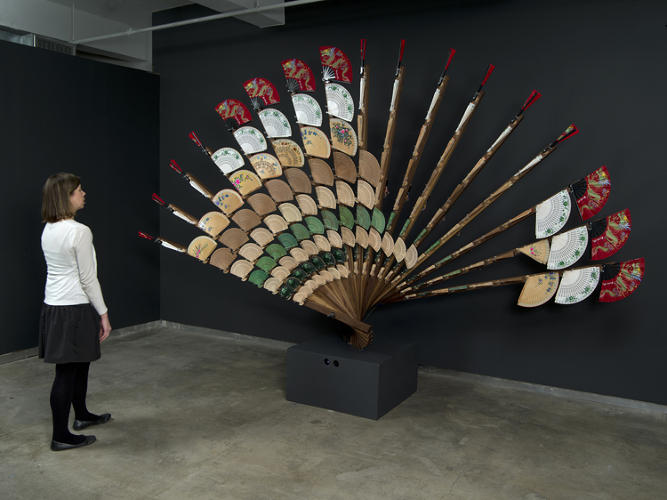 <p>Rozin's algorithm takes input from a camera trained on the viewer and translates it into pixelated data, which is mimicked by the rotation of the fans.</p>