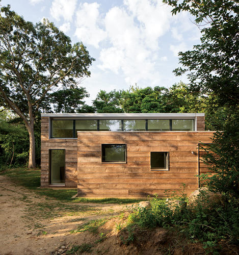 <p>Designed by New York-based Ryall Porter Sheridan, his artists' studio in Orient, New York, sits on columns to interfere minimally with the ground below. The facade is clad in salvaged Douglas fir joists, and the roof features solar photovoltaic panels.</p>