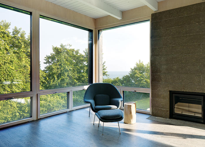 <p>The clients' home was also retrofitted to meet Passive House standards. Here, expansive high-performance windows provide views to the water.</p>
