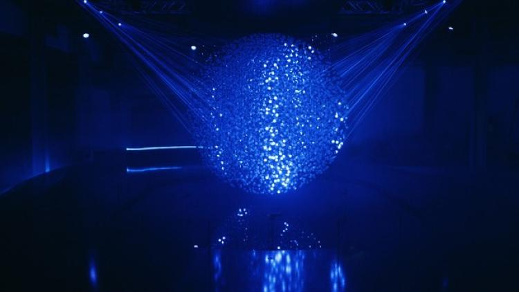 <p>Using projection mapping, blue laser lights dance on their surfaces.</p>