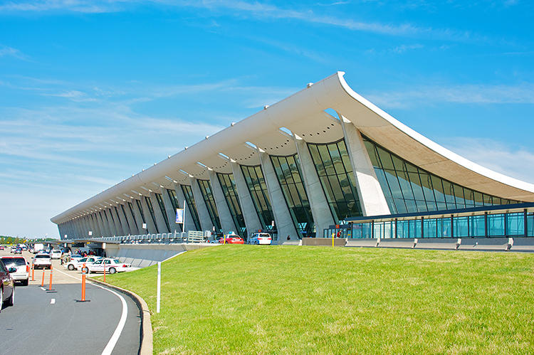 <p>Eero Saarinen's jet-age design for Dulles Airport, located 26 miles from Washington, DC, is a rare synthesis of architecture and engineering. The structure, which consists of angled pylons holding aloft a swooping roof, was meant to rival Washington's monuments.</p>